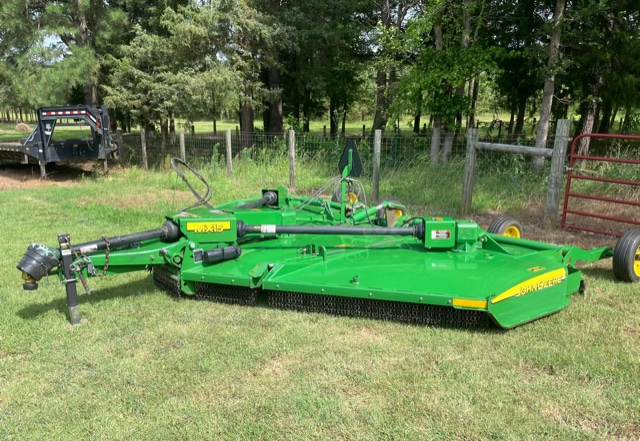A Machine Parked Next To A Green Field
